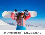happy cheerful woman in a ski... | Shutterstock . vector #1262932642