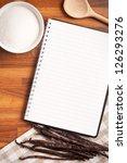 the blank recipe book and vanilla pods - stock photo