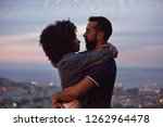 young woman with afro hugging... | Shutterstock . vector #1262964478