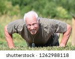 male veteran and muscles... | Shutterstock . vector #1262988118