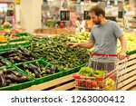 male customer do shopping with... | Shutterstock . vector #1263000412