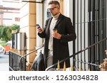 handsome man wearing a coat... | Shutterstock . vector #1263034828