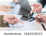 Small photo of Blur image of a businessman in a meeting room.Group of business people who are attending the meeting to summarize their business performance to calculate annual income and profit.