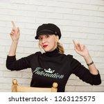 portrait of a beautiful blonde... | Shutterstock . vector #1263125575