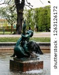 boy on a swan a fountain in the ... | Shutterstock . vector #1263126172