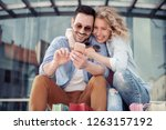 young loving couple sitting in... | Shutterstock . vector #1263157192