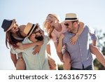 friends having fun on the beach ... | Shutterstock . vector #1263167575