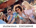 group of attractive young... | Shutterstock . vector #1263168448