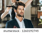 cropped shot of hairstylist... | Shutterstock . vector #1263192745