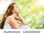 calm beautiful smiling young... | Shutterstock . vector #1263203602