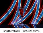 a single wine glass isolated on ... | Shutterstock . vector #1263215098