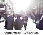 urban girl striding through... | Shutterstock . vector #126321986
