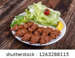 """Small photo of Cig kofte, a raw meat dish in Turkish and Armenian cuisines. Turkish cig means """"raw"""" and kofte means meatball."""
