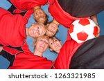 smiling teenage girls in soccer ... | Shutterstock . vector #1263321985