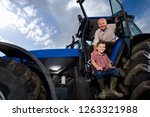 grandson with grandfather... | Shutterstock . vector #1263321988