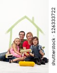 Family with two kids repainting their home concept - together holding utensils - stock photo