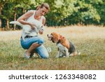 woman introducing her cat to... | Shutterstock . vector #1263348082