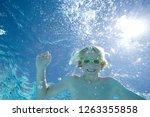 underwater view of boy wearing... | Shutterstock . vector #1263355858