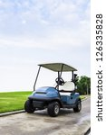 A Golf Cart With Clubs On Way...