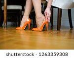 the bride wears orange wedding...   Shutterstock . vector #1263359308