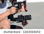 videographer shoots video with... | Shutterstock . vector #1263363652
