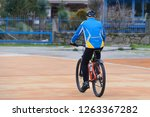 elderly man riding a bicycle | Shutterstock . vector #1263367282