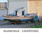 wooden fishing boat is drying... | Shutterstock . vector #1263431062
