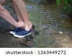 woman helps a child shoe... | Shutterstock . vector #1263449272