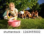 friends by tent on camping trip ... | Shutterstock . vector #1263455032