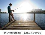 teenage boy fishing in lake... | Shutterstock . vector #1263464998