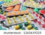 heap of different pills in... | Shutterstock . vector #1263619225