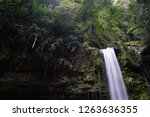 mahua waterfall is a plunge... | Shutterstock . vector #1263636355