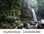 mahua waterfall is a plunge... | Shutterstock . vector #1263636382