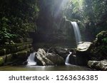mahua waterfall is a plunge... | Shutterstock . vector #1263636385