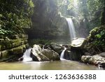 mahua waterfall is a plunge... | Shutterstock . vector #1263636388