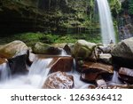 mahua waterfall is a plunge... | Shutterstock . vector #1263636412