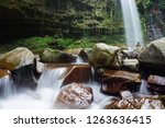 mahua waterfall is a plunge... | Shutterstock . vector #1263636415