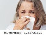 ailing elderly woman wipes her... | Shutterstock . vector #1263721822