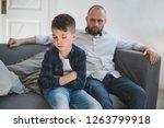 A Sad And Resentful Boy Sits...