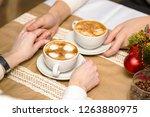 boy and girl drink latte coffee ...   Shutterstock . vector #1263880975