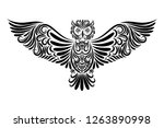 Stock vector vector illustration of a black owl from an ornament on a white background tattoo symbol flying 1263890998
