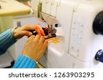woman sews clothes on a sewing... | Shutterstock . vector #1263903295