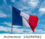 french flag in blue sky | Shutterstock . vector #1263965062