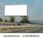 blank billboard on blue sky... | Shutterstock . vector #1264083622