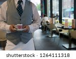 close up of caf  waiter in... | Shutterstock . vector #1264111318