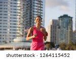 active woman in sportswear... | Shutterstock . vector #1264115452