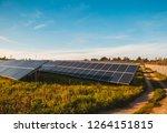 solar panels on a field    Shutterstock . vector #1264151815