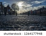 old cobbled road catching the...   Shutterstock . vector #1264177948