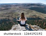a young active girl sits on the ... | Shutterstock . vector #1264192192
