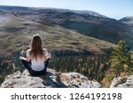 a young active girl sits on the ... | Shutterstock . vector #1264192198